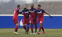 Quincy Amarikwa of Chicago Fire celebrates his goal with Shaun Maloney of Chicago Fire and teammates