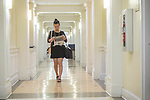 Senior music major, drum major, flutist and violinist Jiwon Lee makes her way to one of her jobs in the Music Building.  Photo by Kevin Bain/Ole Miss Communications