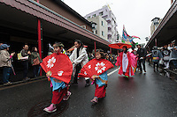 Shrine maidens lead the parade of phallus mikoshi during the Kanamara festival for the steel phallus in Kawasaki Daishi, Kanagawa, Japan. Sunday April 5th 2015 The Kanamara penis festival celebrates a legend about the defeat of a penis-eating demon. It is a wildly popular festival attracting large numbers of locals and foreigners.