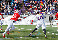 University at Albany Men's Lacrosse defeats Cornell 11-9 on Mar 4 at Casey Stadium.  Kyle McClancy shoots.  Defended by Jordan Dowiak (#23).