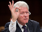 Former President Bill Clinton, chairman of the William J. Clinton Foundation, testifies during the Senate Foreign Relations Committee hearing on global health initiatives on March 10, 2010.