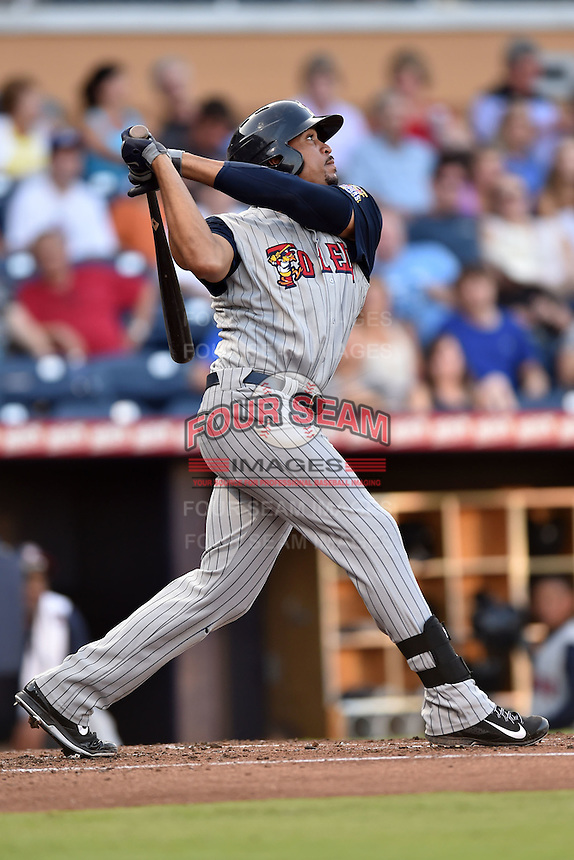 Toledo Mud Hens left fielder Daniel Fields #7 swings at a pitch during a game against the Durham Bulls at Durham Bulls Athletic Park on July 25, 2014 in Durham, North Carolina. The Mud Hens defeated the Bulls 5-3. (Tony Farlow/Four Seam Images)