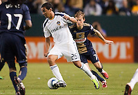 LA Galaxy forward Miguel Lopez (25) moves with the ball. The LA Galaxy defeated the Philadelphia Union 1-0 at Home Depot Center stadium in Carson, California on  April  2, 2011....