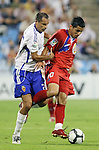 Gatafe's Juan Albin (r) and Zaragoza's Marco Babic during La Liga match. September 27 2009. (ALTERPHOTOS/Acero).