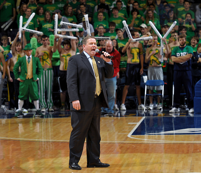 Dec. 19, 2009; South Bend, IN, USA; Notre Dame Football Coach Brian Kelly speaks to the crowd during halftime at the Notre Dame-UCLA basketball game.
