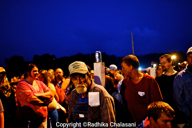 WISE, VIRGINIA-JULY 25:  People wait before dawn to enter the Virginia-Kentucky Fairgrounds for free medical care from the Remote Area Medical (RAM) Expedition in the heart of the Appalachian Mountains  July 25, 2009. Many have slept overnight  in their cars, trucks, RVS or in tents. The two and half-day event helped provide health care for 2,715 people, most of whom are uninsured or underinsured with unaffordable co-pays or high deductibles for their insurance policies. An army of seventeen hundred volunteers including individual doctors, nurses, members of the UVa medical and nursing schools, and the Lions Club helped organized the event and provide services. Organizers estimate that they provided over $1.6 million USD worth of care.