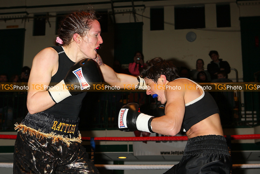 Areti Mastrodouka (black shorts) defeats Kristine Shergold in a Super-Featherweight boxing contest at York Hall, Bethnal Green, promoted by Left Jab - 04/03/11 - MANDATORY CREDIT: Gavin Ellis/TGSPHOTO - Self billing applies where appropriate - 0845 094 6026 - contact@tgsphoto.co.uk - NO UNPAID USE.