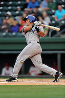 Catcher Wilfredo Rodriguez (3) of the Asheville Tourists bats in a game against the Greenville Drive on Monday, April 21, 2014, at Fluor Field at the West End in Greenville, South Carolina. Greenville won, 8-3. (Tom Priddy/Four Seam Images)