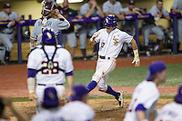 LSU Tigers second baseman Jared Foster (17) scores the winning run in the bottom of the ninth inning of Southeastern Conference baseball game against the Texas A&M Aggies on April 23, 2015 at Alex Box Stadium in Baton Rouge, Louisiana. LSU defeated Texas A&M 4-3. (Andrew Woolley/Four Seam Images)