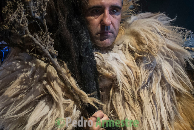 "A man dressed for Carantoña before mass during the Carantoñas festival, in Acehúche near Cáceres, on January 21, 2015. The ""Carantoñas"", monster-animal characters mixing paganism with Christianity, search for Saint Sebastian in the streets of the village of Acehúche, southwestern Estremadure province, dressed in patchwork sheep, cow, rabbit and goatskins under painted masks. Arriving eventually at the village church, a procession takes place with the statue of the patron saint. Until recently, Spain's neighbors, the Berbers of Morocco, preserved a version of the same ritual in their animal-hided winter ""goblin,"" Bou Inania.  © Pedro ARMESTRE"