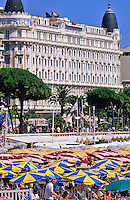 France. Cannes. Crowded beach, La Croisette and Carlton Hotel. Provence. Cote d?Azur.