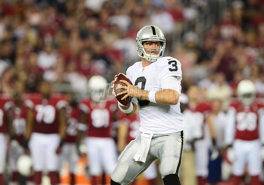 Aug. 17, 2012; Glendale, AZ, USA; Oakland Raiders quarterback (3) Carson Palmer drops back to pass in the first half against the Arizona Cardinals during a preseason game at University of Phoenix Stadium. Mandatory Credit: Mark J. Rebilas-