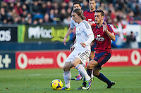 14.12.2013, Pamplona, Spain. La Liga football Osasuna  versus  Real Madrid.    Modric, Real Madrid midfielder, during the game between Osasuna and Real Madrid  from the Estadio de El Sadar.