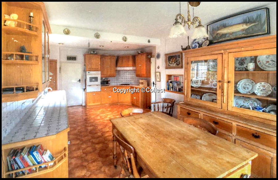 BNPS.co.uk (01202 558833)<br /> Pic:  Collect/BNPS<br /> <br /> The kitchen of the house before the renovation.<br /> <br /> A brand new luxury house that wouldn't look out of place in a rural village but is literally a stone's throw from the beach has gone on the market for £3.25m.<br /> <br /> Gallic House has just been built in a sought-after gated coastal estate in the East Preston West Sussex.<br /> <br /> At the bottom of the garden an 8ft tall hedge has been grown to stop any nosey beachgoers from peering in.<br /> <br /> To make up for the lack of sea views from the ground floor, there is a large first floor balcony that looks out onto the beach and sea.