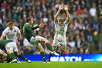 Joe Launchbury of England attempts to block the kick of Ruan Pienaar of South Africa during the QBE Autumn International match between England and South Africa at Twickenham on Saturday 24 November 2012 (Photo by Rob Munro)