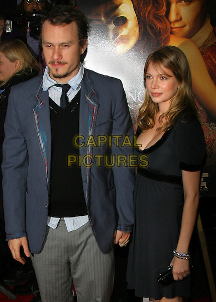 HEATH LEDGER & MICHELLE WILLIAMS.NY premiere of Casanova., New York, NY..December 12th, 2005.Photo: Jackson Lee/Admedia/Capital Pictures.Ref: JL/ADM.half length celebrity couple holding hands blue jacket black dress.www.capitalpictures.com.sales@capitalpictures.com.© Capital Pictures.