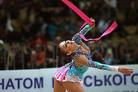 "Evgenia Kanaeva of Russia performs with ribbon at 2008 World Cup Kiev, ""Deriugina Cup"" in Kiev, Ukraine on March 22, 2008. .Photo note: Closeup view version."