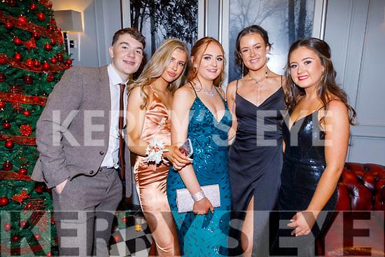 Michael Moynihan, Ellen Wallace, Clodagh O'Connor, Aoife Dillane and Anna Scanlon attending the Gaelcoláiste Chiarraí Debs in the Ballyroe Heights Hotel on Thursday night