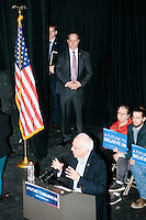 With Secret Service in the wings, Vermont senator and Democratic presidential candidate Bernie Sanders speaks at a town hall at the Rochester Opera House in Rochester, New Hampshire, on Thurs., Feb. 4, 2016. Press and attendee turnout was low for the event because of scheduling issues. The rally had been scheduled for the previous day, postponed, and then rescheduled just a few hours before the event took place. Later that night, Sanders took part in an MSNBC-sponsored debate with Hillary Rodham Clinton.