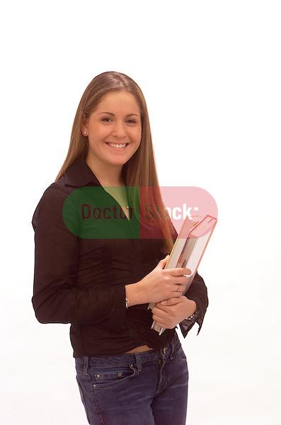 portrait of teenage girl holding school books