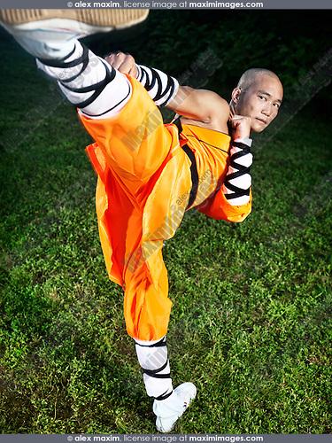 Shaolin warrior monk doing Chuai Tui side kick