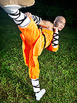 Shaolin warrior monk doing Chuai Tui side kick