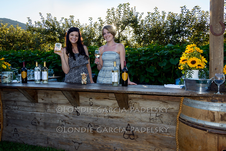 Girls serving wine at the bar. Avila Valley Barn, San Luis Obispo, California
