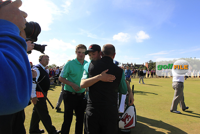 Ewen Ferguson (SCO), Cormac Sharvin (IRL), Nigel Edwards (GB&amp;Ireland team captain) celebrates on the 18th during the sunday morning foursomes for the Walker Cup, Royal Lytham St Annes, Lytham St Annes, Lancashire, England. 13/09/2015<br /> Picture Golffile | Fran Caffrey<br /> <br /> <br /> All photo usage must carry mandatory copyright credit (&copy; Golffile | Fran Caffrey)