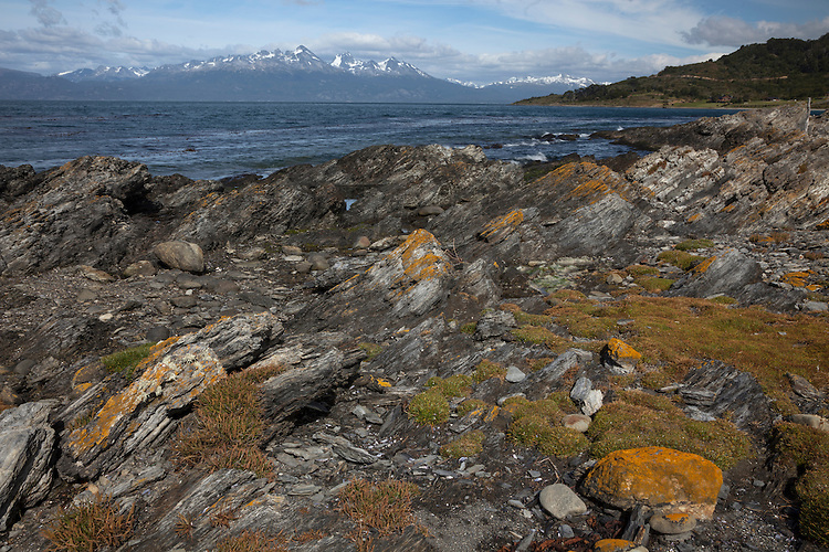 A colorful shoreline rims Beagle Channel at Tierra del Fuego, Argentina