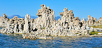 "Sept. 5, 2010 - Mono Lake, California, U.S. - Tufa towers are seen along the shore of Mono Lake near Lee Vining, California with the towering Sierra Mountain range in the background.  ""tufa towers,"" are calcium-carbonate spires and knobs formed by interaction of freshwater springs and alkaline lake water.Mono Lake is a majestic body of water covering about 70 square miles. It is an ancient lake, over 1 million years old -- one of the oldest lakes in North America. It has no outlet and no fish; instead it is home to trillions of brine shrimp and alkali flies. (Photo by Alan Greth/ZUMA Press)"