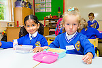 Sukaina Moosvi, Anisa Topalli are enjoying their first day in Junior Infants at CBS primary  on Tuesday