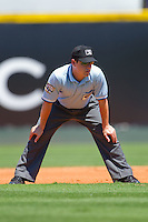 Second base umpire D.J. Rayburn during an International League game between the Norfolk Tides and the Charlotte Knights at Knights Stadium July 5, 2010, in Fort Mill, South Carolina.  Photo by Brian Westerholt / Four Seam Images