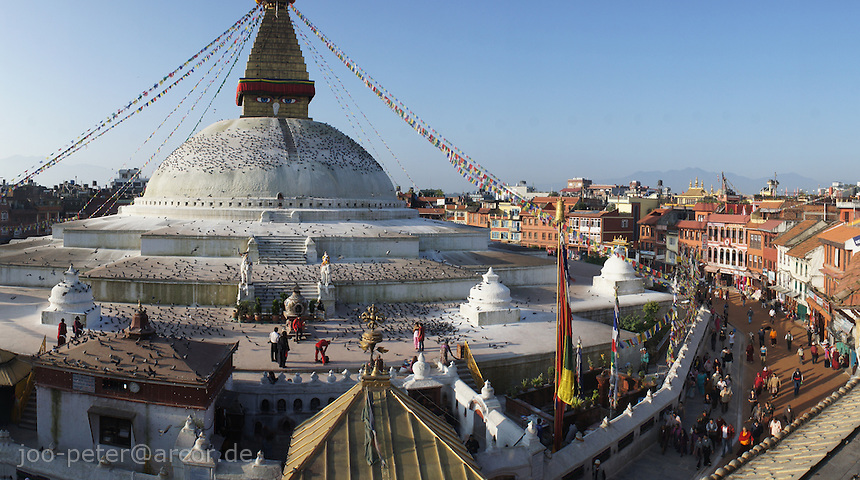 Boudha stupa with street scene, Boudhanath, Kathmandu, Nepal. - Boudhanath near Kathmandu is one of the most holy places of buddhist worship and pilgrimage. The ancient Stupa is one of the largest in the world.