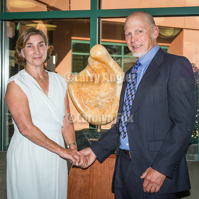 Sutter Amador Hospital annual reception to honor donors to the Sutter Amador Foundation<br /> <br /> Suzanne  and Dr. Lincoln Russin donate a marble sculpture carved by his father the famed Robert Russin of Wyoming to Sutter Amador for many to enjoy.