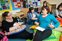 "A breastfeeding consultant giving advice to a mother who is breastfeeding her baby at a drop-in breastfeeding support centre.<br /> <br /> Image from the ""We Do It In Public"" documentary photography project collection: <br />  www.breastfeedinginpublic.co.uk<br /> <br /> Dorset, England, UK<br /> 17/04/2013"