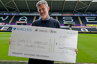 Friday 11 April 2014<br /> Pictured: Tony Clements of Swansea Harriers<br /> Re: Swansaid Cheque Presentation at the Liberty Stadium, Swansea Wales