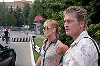 Odinitsovo, Russia, 26/06/2007..German heroin addict Christian Rambow outside the guarded entrance to the military hospital which houses Doctor Zobin's Medical Centre For Drug And Alcohol Dependence. The centre, which uses radical therapy developed by the former military doctor to treat Russian soldiers who became addicted in Afghanistan, claims an 85% success rate in curing heroin addiction. Christian is accompanied by Nicole Gyr, who was herself cured at the centre, and now organises visits for other addicts seeking treatment.