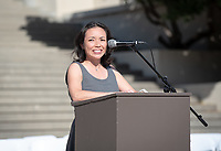 Faculty speaker Cheryl Okumura, Assistant Professor, Biology. Graduating seniors, family, faculty and staff gather for the Asian Pacific Islander Graduation Celebration in the Academic Quad and steps between Johnson and Fowler Halls on Friday, May 17, 2019.<br />