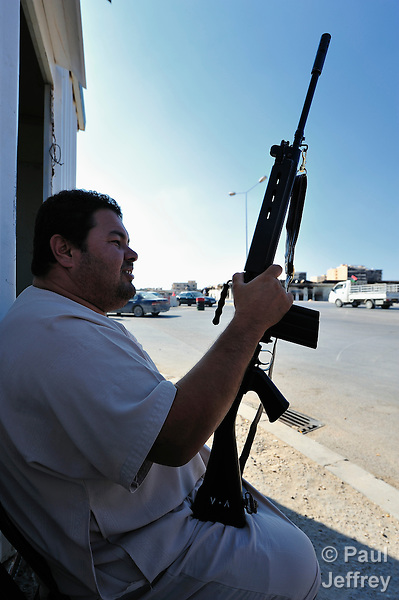 In the rebel enclave of Misrata, Libya, armed fighters at frequent checkpoints keep a look out for supporters of strongman Moammar Gadhafi.