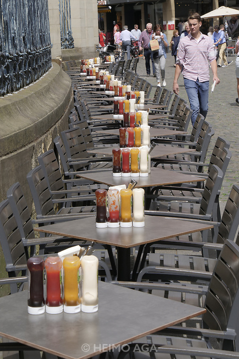 M&uuml;nster, Germany. Opening days of Skulptur Projekte 2017.<br /> Real life sculpture at a restaurant: BBQ sauce, ketchup, mustard, mayonnaise.