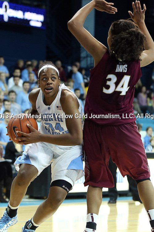 31 January 2013: North Carolina's Xylina McDaniel (left) and Florida State's Chelsea Davis (right). The University of North Carolina Tar Heels played the Florida State University Seminoles at Carmichael Arena in Chapel Hill, North Carolina in an NCAA Division I Women's Basketball game. UNC won the game 72-62.