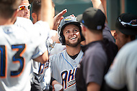 Akron RubberDucks second baseman Todd Hankins (8) high fives teammates in the dugout after hitting a home run during the second game of a doubleheader against the Bowie Baysox on June 5, 2016 at Prince George's Stadium in Bowie, Maryland.  Bowie defeated Akron 12-7.  (Mike Janes/Four Seam Images)
