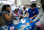 Participants create paper m&acirc;ch&eacute; ornaments during the La Posada Celebration at Western Nevada College, in Carson City, Nev., on Saturday, Dec. 15, 2018. <br /> Photo by Cathleen Allison/Nevada Momentum