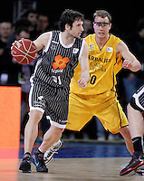 Herbalife Gran Canaria's Ryan Toolson (r) and Uxue Bilbao Basket's Raul Lopez during Spanish Basketball King's Cup match.February 07,2013. (ALTERPHOTOS/Acero)