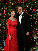 United States President George W. Bush and first lady Laura Bush pose for their official Christmas portrait in front of the White House Christmas Tree in the Blue Room at the White House in Washington, DC on December 7, 2003. <br /> Mandatory Credit: Eric Draper - White House via CNP