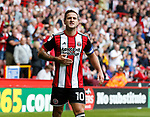 Billy Sharp of Sheffield Utd responds the the taunts of Barnsley fans as he celebrates scoring the first goal during the Championship League match at Bramall Lane Stadium, Sheffield. Picture date 19th August 2017. Picture credit should read: Simon Bellis/Sportimage