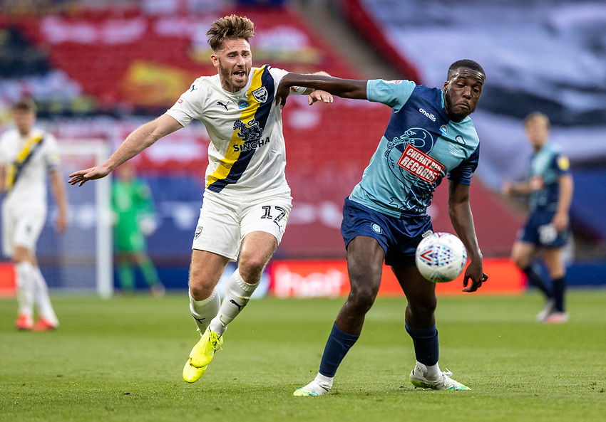 Wycombe Wanderers' Nnamdi Ofoborh (right) competing with Oxford United's James Henry <br /> <br /> Photographer Andrew Kearns/CameraSport<br /> <br /> Sky Bet League One Play Off Final - Oxford United v Wycombe Wanderers - Monday July 13th 2020 - Wembley Stadium - London<br /> <br /> World Copyright © 2020 CameraSport. All rights reserved. 43 Linden Ave. Countesthorpe. Leicester. England. LE8 5PG - Tel: +44 (0) 116 277 4147 - admin@camerasport.com - www.camerasport.com