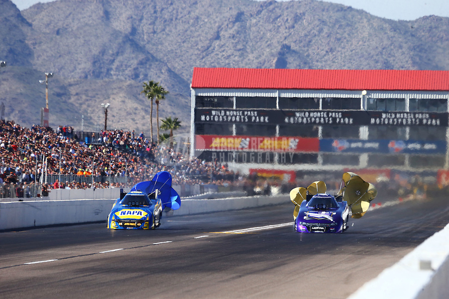 Feb 25, 2017; Chandler, AZ, USA; NHRA funny car driver Ron Capps (left) deploys his parachutes alongside teammate Jack Beckman during qualifying for the Arizona Nationals at Wild Horse Pass Motorsports Park. Mandatory Credit: Mark J. Rebilas-USA TODAY Sports