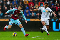 Burnley's Johann Gudmundsson vies for possession with Swansea City's Kyle Naughton<br /> <br /> Photographer Ashley Crowden/CameraSport<br /> <br /> The Premier League - Swansea City v Burnley - Saturday 10th February 2018 - Liberty Stadium - Swansea<br /> <br /> World Copyright &copy; 2018 CameraSport. All rights reserved. 43 Linden Ave. Countesthorpe. Leicester. England. LE8 5PG - Tel: +44 (0) 116 277 4147 - admin@camerasport.com - www.camerasport.com