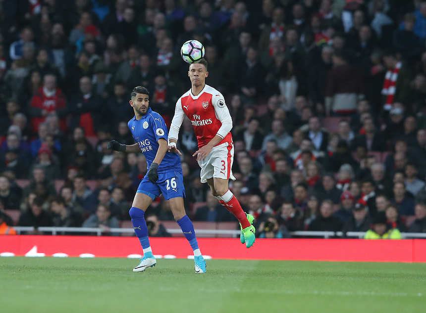 Arsenal's Kieran Gibbs and Leicester City's Riyad Mahrez<br /> <br /> Photographer Stephen White/CameraSport<br /> <br /> The Premier League - Arsenal v Leicester City - Wednesday 26th April 2017 - Emirates Stadium - London<br /> <br /> World Copyright &copy; 2017 CameraSport. All rights reserved. 43 Linden Ave. Countesthorpe. Leicester. England. LE8 5PG - Tel: +44 (0) 116 277 4147 - admin@camerasport.com - www.camerasport.com